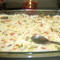 Club Chicken Casserole Recipe - This chicken-and-rice casserole is supplemented with canned mushrooms and pimentos.