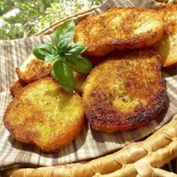 Garlic Crouton Slices Recipe - Get large crisp croutons ideal for French onion soup with this recipe.