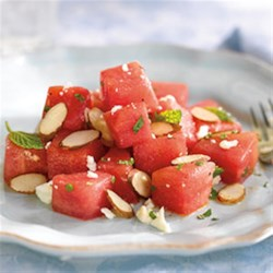 Watermelon, Almond, Feta and Mint Salad Recipe - This salad is fresh and juicy with sweet watermelon, tangy feta and crunchy honey roasted Wonderful(R) Almond Accents.