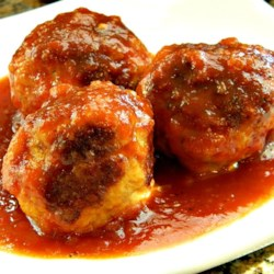 BBQ Meatballs Recipe - Get out your biggest pot!  This recipes makes tons of yummy meatballs simmered in a tangy barbeque sauce - perfect for a big gathering.  I always get lots of requests for this one.