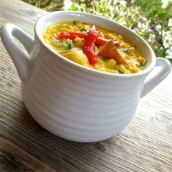 Cranked Up Corn Chowder Recipe - Roasted fresh corn and canned cream-style corn are both used in this hearty corn chowder, chock full of potatoes, celery, and carrots.
