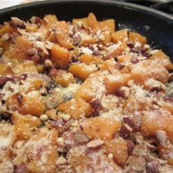Butternut Squash With Cranberries and Almonds Recipe - Winter is the perfect time to savor sweet butternut squash cooked with brown sugar and dried cranberries. It's a quick side even squash-haters will love.