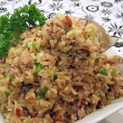 Ke's Cajun (Dirty) Rice Recipe - This brown rice dish made with ground turkey gets a Cajun kick from onion, green pepper, and seasonings. Serve as a side with another Cajun dish, or just enjoy as a light supper by itself.