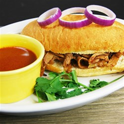 HERDEZ(R) Drowned Beef Sandwich with Chipotle Sauce (Torta Ahogada) Recipe and Video - Served with a spicy beef broth for dipping, these roast beef sandwiches on crusty rolls--a variation on a traditional Mexican 'drowned sandwich'--make a hearty lunch or quick dinner.