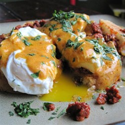 HERDEZ(R) Eggs Bandito Recipe - This spicy variation on eggs Benedict uses red guajillo chile cooking sauce in the hollandaise sauce and chorizo sausage instead of Canadian bacon.