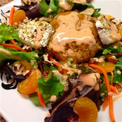 HERDEZ(R) Guajillo Crab Cake Salad Recipe - Spring greens, carrots, pecans, and mandarin orange sections are drizzled with a spicy ranch dressing and topped with crisp, golden brown crab cakes seasoned with red guajillo chile sauce.