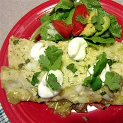 HERDEZ(R) Turkey and Zucchini Enchiladas with Tomatillo Verde Sauce Recipe - A delicious healthy twist on enchiladas. Beef is replaced with ground turkey and zucchini is used in the filling without sacrificing any flavor. The addition of HERDEZ(R) Tomatillo Verde Mexican Cooking Sauce makes this dish easy and takes the flavor over the edge. Your family will never know they are eating healthy!