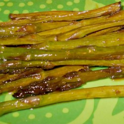 Asian Inspired Grilled Asparagus Recipe - Grilled asparagus spears are coated with soy sauce and sesame oil for an Asian-inspired summer side dish.