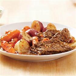 KRAFT RECIPE MAKERS New England Pot Roast Recipe - Your slow cooker does the work and the Classic Herb Simmer Sauce and Farmhouse Style Brown Gravy Finishing Sauce bring the flavor to this delicious pot roast with red potatoes and baby carrots.