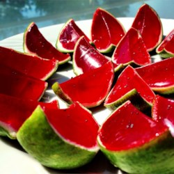 Sliced Watermelon Jell-O(R) Shots Recipe - Cute little watermelon-slice shots made with watermelon-flavored gelatin, vodka, and fresh lime peels pack a kick, but you can make a fun kids' version by leaving out the vodka and adding a cup of cold water.