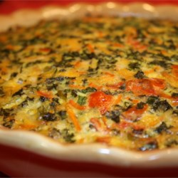 Summer Garden Crustless Quiche Recipe - This flavorful crustless quiche is loaded with so many veggies and Cheddar cheese you won't even miss the crust.