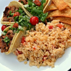 Easy Spanish Rice Recipe - Quick and easy Spanish rice is ready in under an hour and uses simple and flavorful ingredients for a family-pleasing side dish.