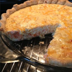 Salmon Quiche Recipe - Salmon and Cheddar cheese are baked together in this simple, yet sophisticated egg pie.