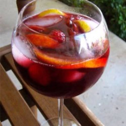 Indian Summer Raspberry Peach Sangria Recipe - Red wine, peach schnapps, and raspberry-flavored soda water are the primary ingredients in this sangria punch with fresh fruit and fruit juices.