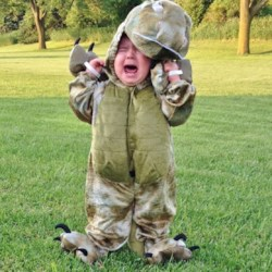 I'm thinking he doesn't like his new dinosaur costume