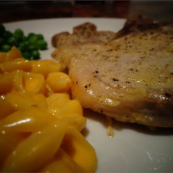 Garlic Seasoned Baked Pork Chops Recipe and Video - Garlic-seasoned baked pork chops are a quick and easy weeknight meal the whole family will be requesting.