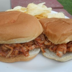 BBQ Chicken Sandwiches Recipe - This is a wonderful pulled chicken sandwich with a homemade barbeque sauce. A perfect party food. Leftovers make great pizza!