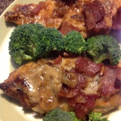 Anniversary Chicken II Recipe - Chicken breasts browned and baked with soy, Parmesan cheese and a bacon/onion mixture. Simply delicious!