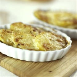 Golden Potato & Herb Bake Recipe - Thin slices of potato are seasoned with melted Becel(R) Buttery Taste margarine and mix of dried basil, thyme and black pepper, layered in a pan and baked until crispy and golden brown.