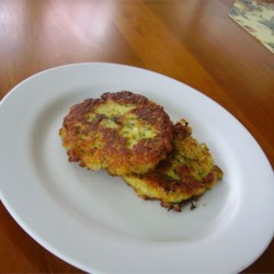 Parmesan Zucchini Patties Recipe - These pan-fried zucchini fritters are flavored with fresh herbs, onions, garlic, and Parmesan cheese.