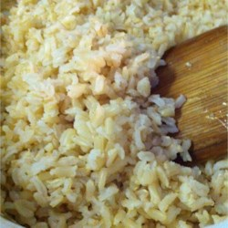 Easy Oven Brown Rice Recipe - Boiling water, a little butter, and salt are all you need for perfect fluffy brown rice.