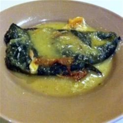 HERDEZ(R) Chiles Rellenos Recipe - Poblano chiles are stuffed with Mexican cheese, dipped in frothy egg whites, and pan-fried until golden. When simmered briefly in tomatillo verde sauce and served with rice, beans, and tortillas these chiles rellenos make a delicious Mexican-inspired meal.