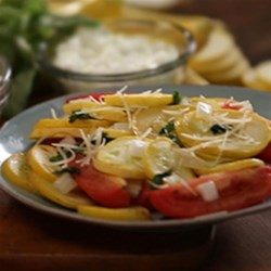 Ashley and Whitney's Yellow Squash and Tomato Packet Recipe - Yellow squash and Roma tomatoes with fresh basil are baked in foil packets for the flavors of summer--and easy clean up.