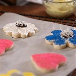 Karen's Rolled Sugar Cookies Recipe - These classic cut-out cookies are easy when you use parchment paper to wrap and chill the dough, then roll out and bake the cookies.