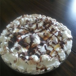 Peanut Butter Pie V Recipe -  Sweet and chunky, this pie 's filling is made from confectioners ' sugar, cream cheese, chunky peanut butter, and whipped topping combined. It 's then spooned into prepared two pie shells and chilled. Garnish with more whipped topping and a sprinkling of chopped peanuts.