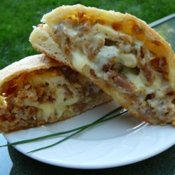 Picnic Sausage Bread Recipe - Sausage and mozzarella cheese rolled into pizza dough makes the perfect portable snack for picnics or ball games.