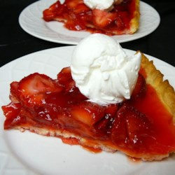 Strawberry Pie V Recipe - This recipe makes 2 pies. A gelatinous topping made with cornstarch and strawberry flavored gelatin is poured over fresh strawberries. Serve with whipped cream.