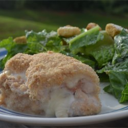 Easy Baked Chicken Cordon Bleu Recipe - Easy recipe that tastes like you cooked all day. Chicken breasts are wrapped around ham and mozzarella cheese for a change in this version of the classic baked dish.