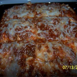 Rice Lasagna Recipe - Mozzarella cheese, cottage cheese, ground beef, and spaghetti sauce are layered with cooked rice in this easy meal.