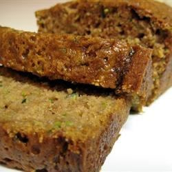 Mom's Zucchini Bread Recipe - A moist and delicious zucchini bread flavored with walnuts and cinnamon. Easy to bake and freeze, this recipe makes two loaves.