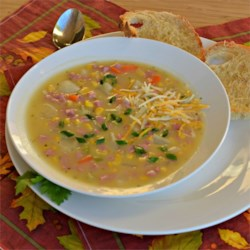 Slow Cooked Ham and Potato Chowder Recipe - A hearty ham and potato soup made in the slow cooker is a great way to use up holiday ham leftovers.