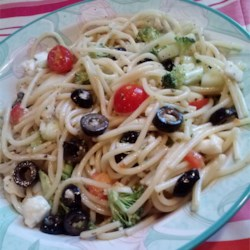 Spaghetti Salad II Recipe - There is far more than just spaghetti in this spicy veggie salad. There 's broccoli, cauliflower, cucumbers, lots of black olives, and two different dressings.
