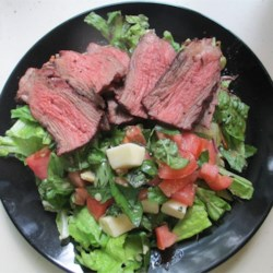 Caprese Salad with Grilled Flank Steak Recipe - Top your Caprese salad with grilled flank steak for a quick and easy summertime dinner.