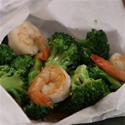 Utokia's Ginger Shrimp and Broccoli with Garlic Recipe - Parchment packets filled with shrimp and broccoli florets and seasoned with an Asian-inspired ginger sauce are baked for a delicious and easy-clean-up dinner.