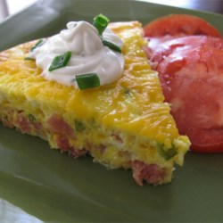 Baked Denver Omelet Recipe - This baked Denver omelet is really a frittata with ham, bell pepper, onion, and Cheddar cheese -- all the classic ingredients of the original.