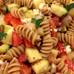 Vegetable Pasta Salad II Recipe - A pile of vegetables with rotini pasta and Feta cheese topped with dressing.