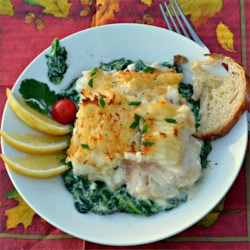 Chef John's Fisherman's Pie Recipe - My Fisherman's Pie gives you flaky cod mingled with spinach in a garlic and lemon-scented sauce underneath a browned crust of creamy, buttery potatoes on top. It really does taste fantastic.