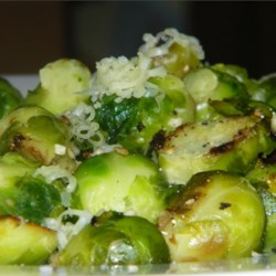 Parmesan Brussels Sprouts Recipe - Impress your guests with Brussels sprouts pan-fried with butter and topped with Parmesan cheese for a holiday side dish.