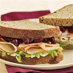 Cranberry Thanksgiving Turkey Sandwich Recipe - Sliced Maple Honey Turkey makes a great sandwich on whole wheat bread with mayo and cranberry sauce.