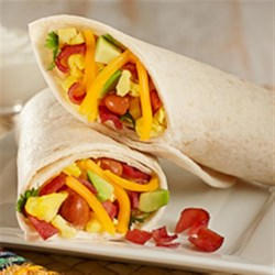 Turkey Bacon Breakfast Burrito Recipe - Start off your day with a hearty burrito packed with chili beans, eggs scrambled with crumbled bacon, shredded cheese, and more!