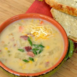 Easy and Delicious Ham and Potato Soup Recipe - A creamy soup is loaded with potatoes, corn, cauliflower, and diced ham for a warm and comforting meal.