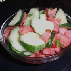 Watermelon-Cucumber Salad with Sushi Vinegar and Lime Recipe - Watermelon and cucumbers are tossed in a light dressing made with seasoned rice vinegar, white wine vinegar, and lime juice for a refreshing summer salad.
