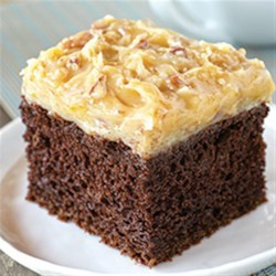 German Chocolate Cake Recipe - Make a great German Chocolate Cake with this easy recipe. The coconut and pecan frosting is deliciously dreamy.