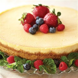 Creamy Baked Cheesecake Recipe - EAGLE BRAND(R) Sweetened Condensed Milk gives this cheesecake a creamy and smooth texture. Top with a raspberry spread, or serve plain.