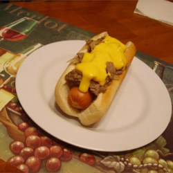 Philly Cheese Steak Dog Recipe - Top your hot dog with all the fixings for Philly cheese steak for a crowd-pleasing part of your 4th of July cookout.