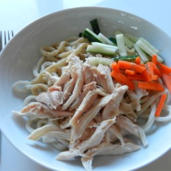 Chicken and Cold Noodles with Spicy Sauce Recipe - Chinese egg noodles cooked in fresh chicken broth are chilled and topped with shredded chicken and a blend of sesame oil, sesame paste, soy sauce, red wine vinegar, peanut oil and minced garlic. Add a touch of chili oil for spice, if desired.